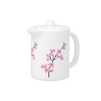 El flor asiático blanco rosado de la tetera florec