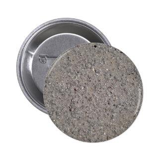El fondo de la arena con las pequeñas piedras se c pins