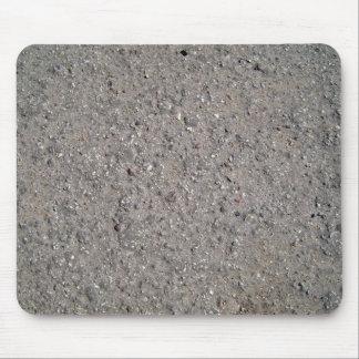 El fondo de la arena con las pequeñas piedras se c alfombrilla de raton