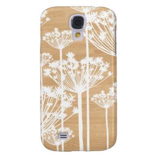 El fondo de madera florece el estampado de flores