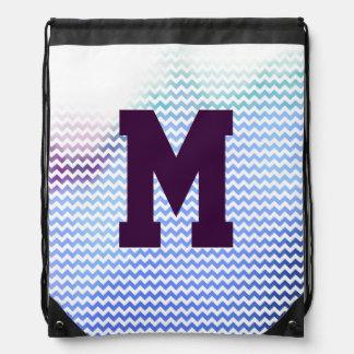el galón con monograma raya inicial mochila