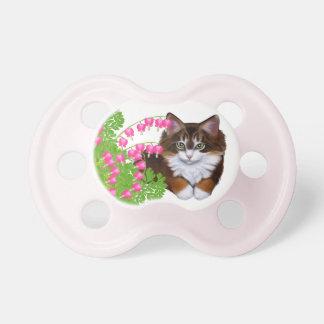 El gatito de la concha en jardín florece el pacifi chupetes de bebe