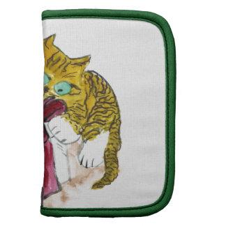 El gatito está desempaquetando un feliz Catmous Planificadores