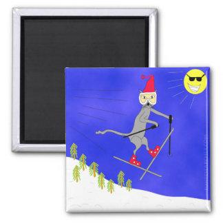 El gatito ingenioso del esquí consigue el aire gra imán cuadrado