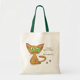 El gatito lindo comió su galleta bolsa tela barata