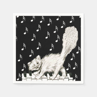 El gato blanco en piano cierra notas de la música servilleta de papel