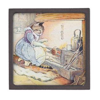 El gato del gatito se sienta por el fuego cajas de recuerdo de calidad