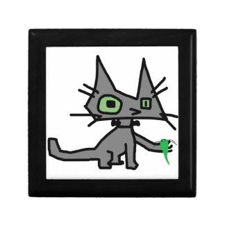 El gato del robot sostiene un juguete del ratón cajas de recuerdo