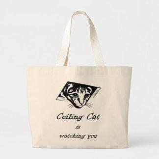 El gato del techo le está mirando bolsa de mano