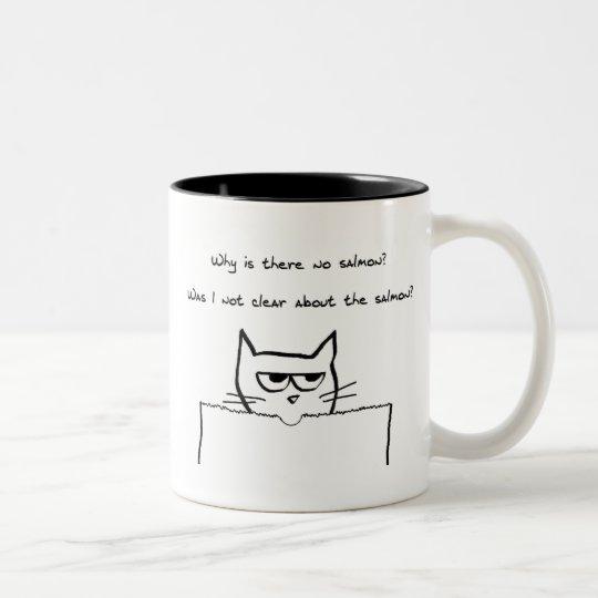 El gato enojado exige salmones taza de café de dos colores