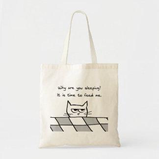 El gato enojado le quiere fuera de cama bolsas de mano