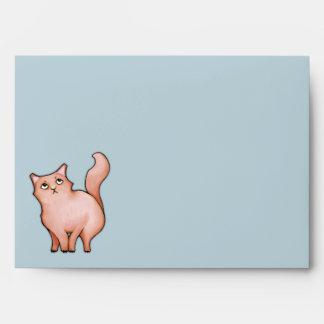 El gato gruñón Sue raya el sobre de la tarjeta A7
