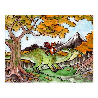 El gato monta un dinosaurio postales