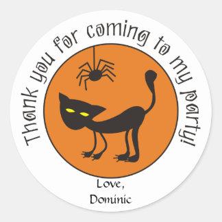 El gato negro y la araña Halloween le agradecen lo