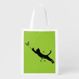 El gato y la versión 2 de la mariposa bolsa para la compra
