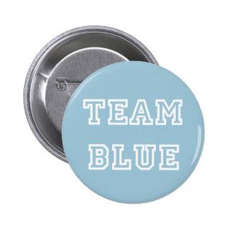 El género azul del equipo revela el botón
