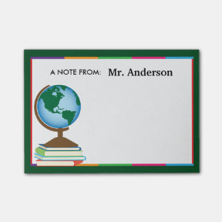 El globo del mundo en la pila de libros post-it® notas