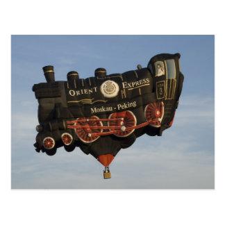El globo toma un tren postales