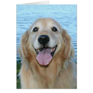 El golden retriever sonriente tiene un día feliz tarjeta de felicitación