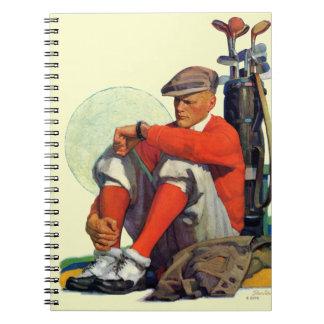 El golfista guardó el esperar libreta espiral