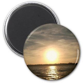 El golfo apuntala puesta del sol/el imán del océan