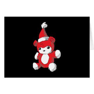 El gorra rojo lindo de Santa del oso de peluche Felicitaciones
