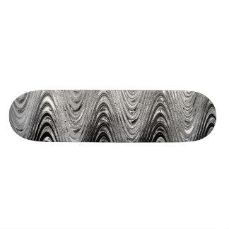 El gris agita el monopatín tabla de patinar