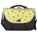 El gris protagoniza el modelo amarillo bolsas de portatil