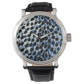 El guepardo de PixDezines mancha el azul Reloj