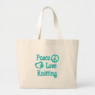 El hacer punto del amor de la paz bolsas