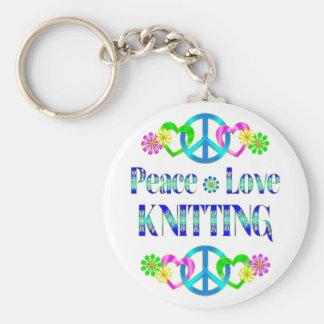 El hacer punto del amor de la paz llaveros