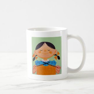 El hacer punto retro del chica del vintage taza de café