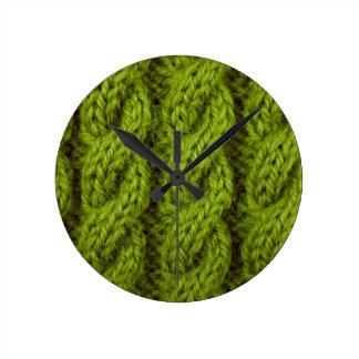 El hacer punto verde del cable reloj