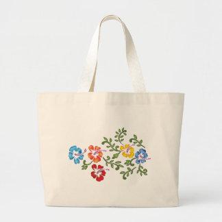 El hibisco florece el ornamento bolsa lienzo