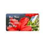 El hibisco rojo florece etiquetas de dirección