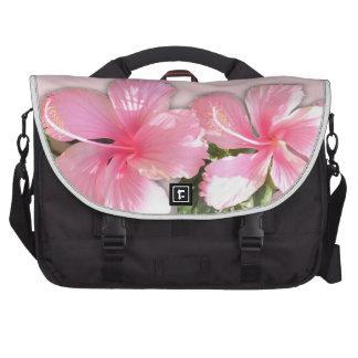 El hibisco rosado brillante florece el bolso del o bolsas para portátil