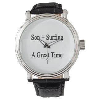El hijo más practicar surf iguala un gran rato relojes de pulsera