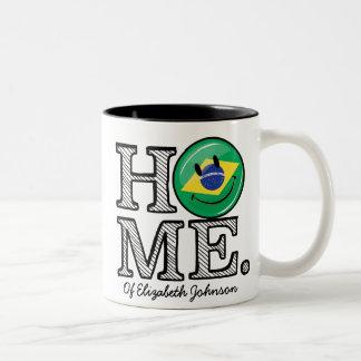 El hogar es calentador sonriente de la casa de la taza de dos tonos