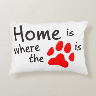 El hogar es donde está la impresión de la pata cojín decorativo