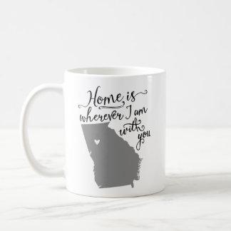 El hogar es dondequiera que sea con usted taza de café