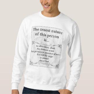 El hombre de la prehistoria de la naturaleza más sudaderas encapuchadas