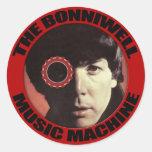 El hombre en la máquina pegatina redonda