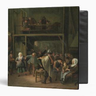 El interior de una taberna con un par que baila a
