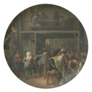 El interior de una taberna con un par que baila a plato de cena