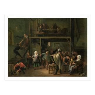 El interior de una taberna con un par que baila a postales