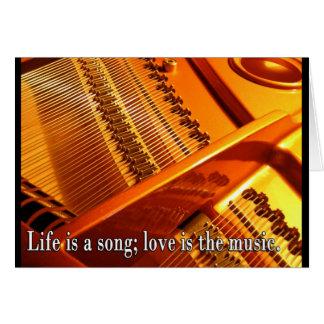 """El interior del piano de cola, """"vida es una canció felicitación"""