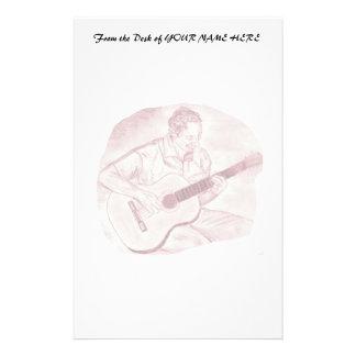 el jugador de la guitarra acústica sienta el bosqu papeleria de diseño