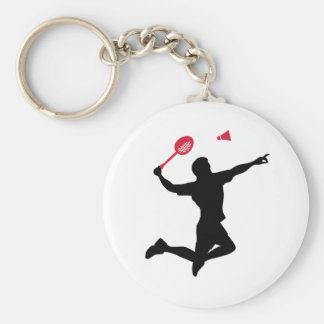 El jugador del bádminton salta llaveros