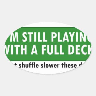 El jugar con una cubierta de tarjetas llena colcomanias ovaladas