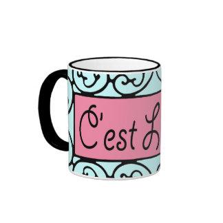 El La de C'est compite (que es vida) la taza/la ta